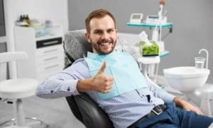man sitting in dental chair